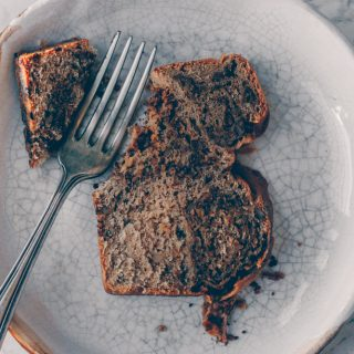 Vegan Povitica - A Croatian Walnut Swirl Bread. It's a sweet yeast bread filled with nuts, cinnamon and coconut sugar. This traditional Eastern European dessert bread is usually made with eggs and milk but I created a vegan recipe for this sweet walnut bread. Recipe by Kati of black.white.vivid. - food photography, croatian recipe, croatian dessert, vegan croatian recipe, rolled nut bread, moody food photography, moody photography, food styling