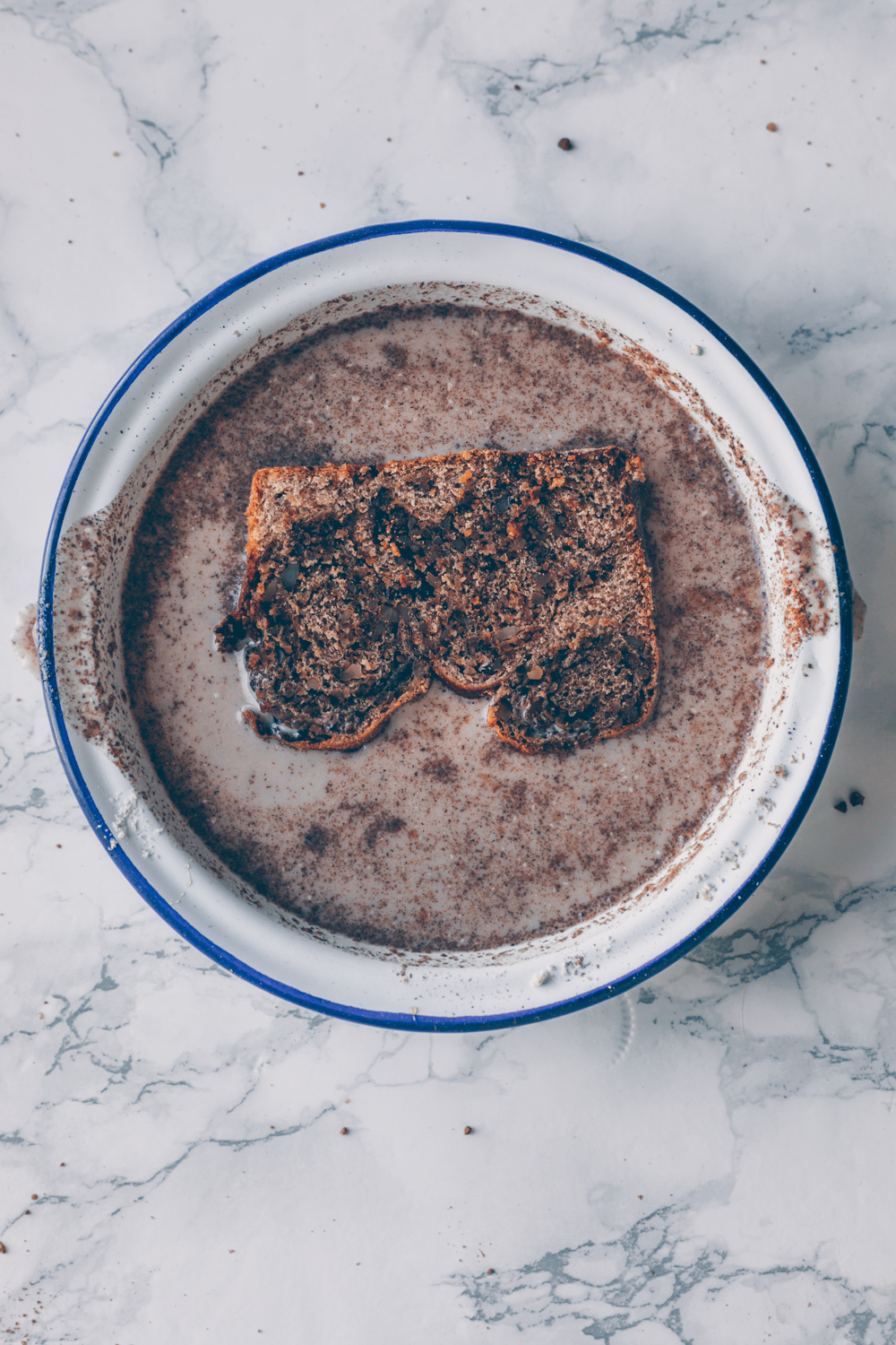 Vegan French Toast with Croatian Walnut Swirl Bread (Povitica) - An easy, quick and healthy-ish breakfast recipe. I made my Vegan French Toast with slices of my Croatian Walnut Swirl Bread but you can use any kind of yeast bread. This recipe for Vegan French Toast refrains from using nutritional yeast and instead comes with a secret ingredient - Kala Namak salt (Indian black salt) which gives the Vegan French Toast a savory, umami and eggy taste. - A Vegan recipe by Kati of black.white.vivid. - food photography, moody photography, matte photography, moody food photography, vegan dessert, vegan breakfast, food styling