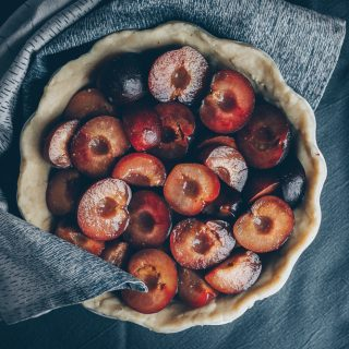 Plum Pie with Honey and Black Pepper - An almost Vegan Recipe by Kati of black.white.vivid. - vegan pie crust, vegan pie, vegan plum pie, vegan tart, vegan cake, vegan plum cake, food photography, food styling, moody food photography, moody photography, dark food photography, dark photography