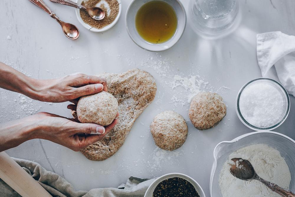 Lebanese Zaatar Manoushe Buns - A Vegan Recipe by Kati of blac.white.vivid. // food photography, food styling, plant-based recipe, vegan lebanese recipe, vegan food, vegan manoushe, hummus, olive oil, mint, lebanese flatbread, vegan flatbread,